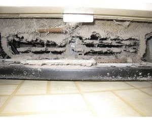 dirty refrigerator coil under refrigerator