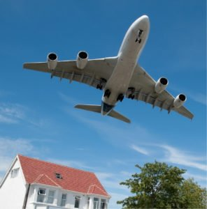 jet flying over a home