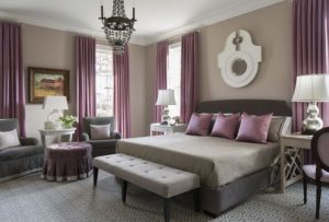 room with medium gray walls and purple accents