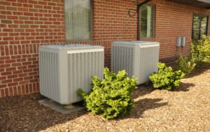 two central air conditioner outdoor units