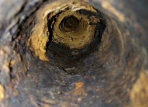 corroded cast iron sewer pipe
