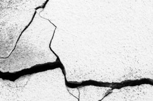 cracked and heaved concrete