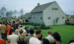 people waiting in line to see a levittown model home