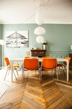 electic dining room with orange accents