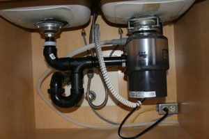 photo under sink showing disposer plugged into an outlet