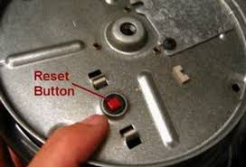 garbage disposer reset button