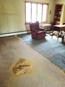 dust and carpet pad remains during carpet replacement