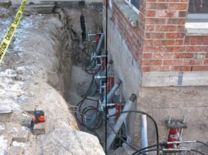 foundation repair hydraulic rams to install pier sections
