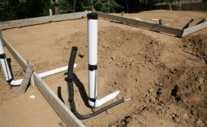 home slab foundation under constrction - water pipes showing
