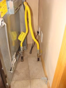 gas range connected to gas supply with yellow flexible gas line