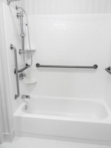 bathtub with grab bars installed