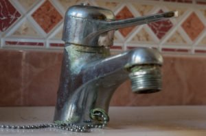 photo of lime build up on a faucet