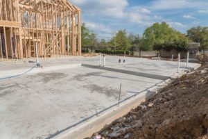 photo of texas home slab foundation with water pipes showing