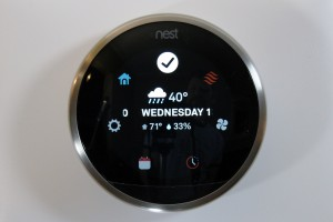 nest thermostat showing weather forecast