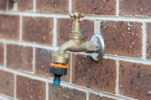 outdoor water faucet in wall