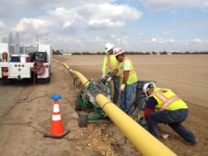 Polyethylene gas main being installed