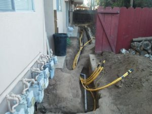 Polyethylene residential gas lines being installed