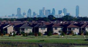 photo of homes in foreground and dallas skyline in background