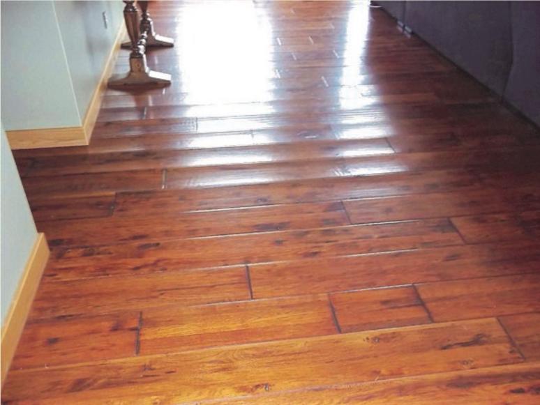 slab leak damage to wood floor