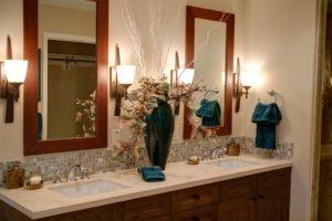 bathroom with wood framed mirros