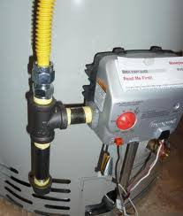 photo of gas line sediment trap installed on gas water heater