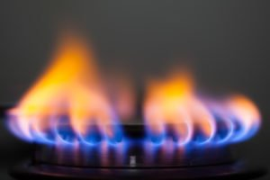 photo of gas burner with yellow flames